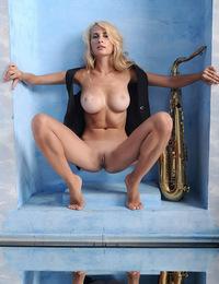 Amanda B: Presenting Amanda by Goncharov - Amanda showcases her impressively well-endowed body and long, svelte legs.