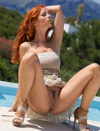 Ariel soaks up the warm morning sun as she bares her voluptuous body, with large, cuppable breasts, meaty ass, and long sexy legs. - Ariel A - Descuid