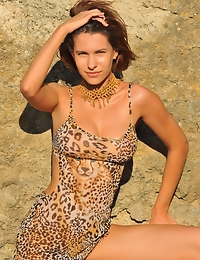 """""""Suzanna A showcases her statuesque figure, her animal printed dress pulled slightly to reveal her round, perky breasts, while the cool frothy wa"""