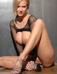 Let me just say this is a good combo, Fishnet and large breasts. - Raylene A - Tsios