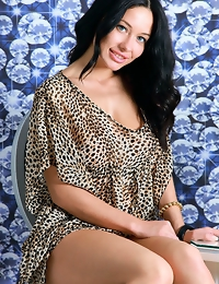 """""""Gorgeous Mila M, strips her printed top and bares her sexy physique with large puffy   breasts in front of the camera."""""""